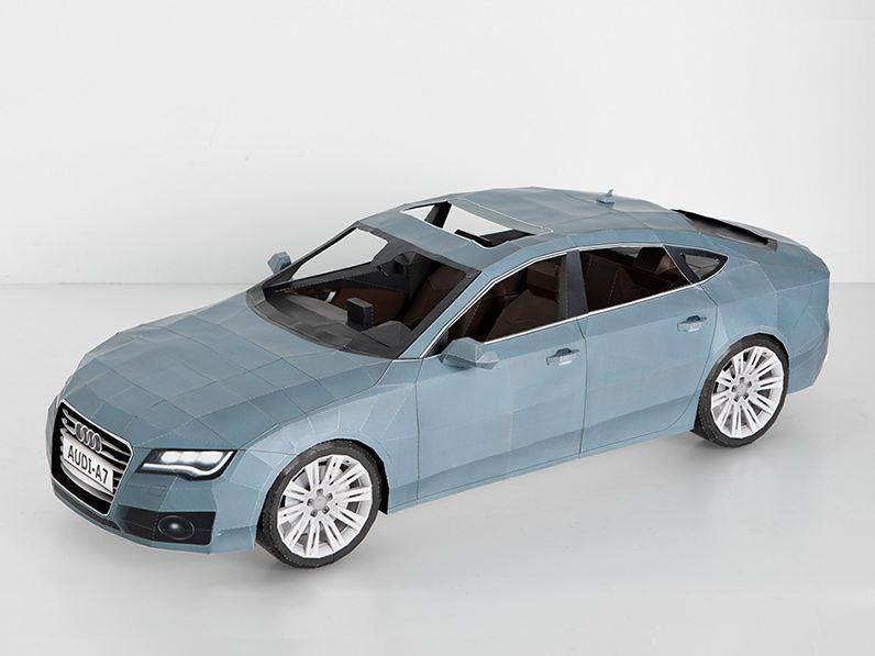 À la demande d'Audi, le designer Taras Lesko a réalisé une Audi A7 entièrement en papier à partir de...